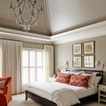 Glorious trundle bed frame Traditional Bedroom in Charlotte with orange pillow and vaulted ceiling