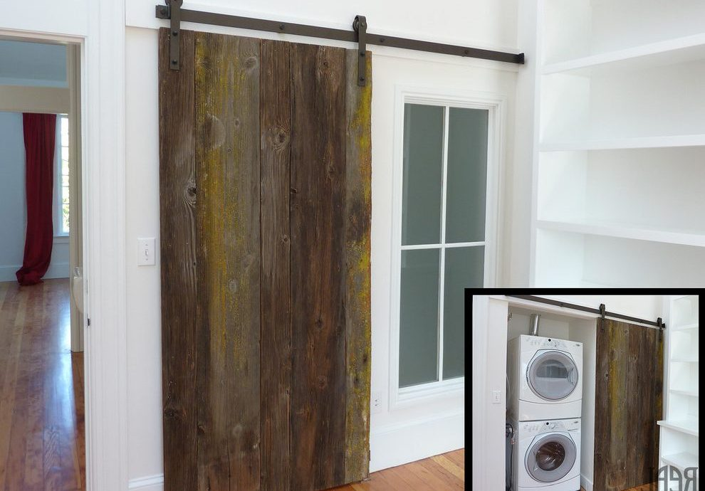 Pleasing interior sliding barn Traditional Laundry Room in Seattle with modern door hardware and craftsman single panel curtains