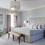Beige Tufted Headboard And White Wood Bed Pillows Beige Tufted Headboard Bench At Foot Of Crown Molding Decorative Drum Pendant Shade Light The Gray