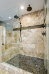 Delightful Taupe Bathroom Bathroom Traditional with TV in The Wall Brown Granite Counter Double Sinks Master Bath Oval Soaker Tub Travertine Tile Master