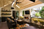 Dishy Kitchen Open Shelves Deck Transitional with Stone Fireplace Wall-mounted TV Covered Patio Composite Decking Black Shelving Outdoor Living Black Ceiling Fan Bar Green Counter Stools