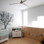 Imaginative Tree Mural Nursery Nursery Modern With Neutral Colors And Wall Decor Ceiling Fan Changing Table Grey Walls Neutral Colors Penant Garland Rocking Horse Wall Decor Mural Wood Flooring Wooden