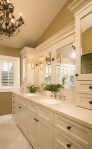 Impressive Marble Slab Colors Bathroom Traditional with Shaker Style White Wood Painted Cabinets Double Sinks Crema Marfil Vaulted Ceiling Chandelier Framed Mirror Rectangular Sink Medicine
