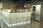 Wonderful Metallic Backsplash Kitchen Modern with Concrete Floor Stainless Steel Appliances Eat in Kitchen Food Storage Range Hood Metal Tile Breakfast Bar Peninsula Clear Barstools