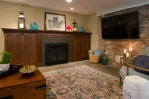 Pretty Basement Tile Floor Basement Traditional with Brick Feature Wall Tv Family Room and Kitchenette/ Bar. Floori Fireplace Surround Built in Cabinets Around