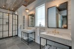 Sparkling Mirrored Ceiling Bathroom Farmhouse with Pendant Light Two Vanities Rustic Wood Panel Walls Vintage Sink Gold Accents industrial Mirror