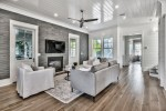 Terrific Shiplap Ceiling Living Room Beach Style with White Slipcovered Armchairs Tongue and Groove Walls Coastal Decor Beach Fan Gray Tile Wall