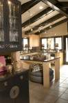 Awesome Suspended Track Lighting Kitchen Eclectic with Exposed Beams Tile Flooring Sloped Ceiling Vaulted Dining Buffet Wood Cabinets Black Trim Kitchen Island Hutch