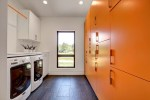 Delightful Built in Cabinets Contemporary Mid Century with Clean Lines White Tile Wall Bright Orange Storage Washer Dryer Slate Flooring Pop Of