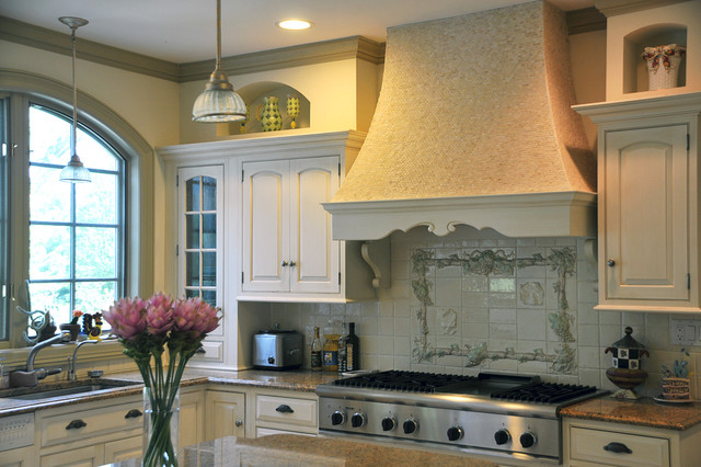Magnificent French Country Settee Kitchen Mediterranean With Range Hood And White Cabinets Arch Window Granite Counters Pendant Lights Range Hood