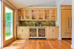 Pretty Green Glass Backsplash Kitchen Modern with Built-in Cabinetry Front Cabinets Cabinet Refrigerator Wine Fridge Kitchen Slate Butler Pantry