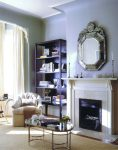 Blooming Oval Glass Coffee Table Living Room Eclectic with White Wood Bookshelves Upholstery Metal Fireplace insert Baseboards Crown Molding Monochrome Flush Hearth