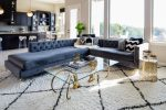 Imaginative Velvet Sectional Living Room Contemporary with Large Windows Brass Fixtures Mismatched Pillows Dark Blue Sofa Gold Accents Diamond Pattern Rug