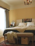 Terrific Pale Yellow Curtains and Drapes Bedroom Traditional with Window Treatments Upholstered Bench Crown Molding Ceiling Lighting Chandelier Headboard Wall Foot Of The Bed Wicker