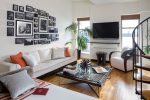 Good-Looking Modern Picture Frames Contemporary War Bachelor Pad with Pop Of Color Photo Arrangement Gallery Wall Black Cushions and Pillows Framed Photos indoor Plants White