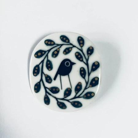 Karen Risby - porcelain brooch with gold lustre glaze