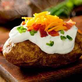 Baked potatoes taste just as good when cooked in the slow cooker! Get this recipe and more at Made in a Pinch. To get recipes and helpful tips follow us on Pinterest!
