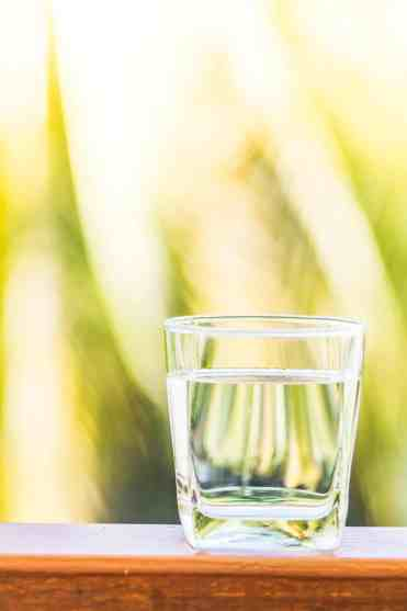 Drink more water daily by keeping a water glass handy