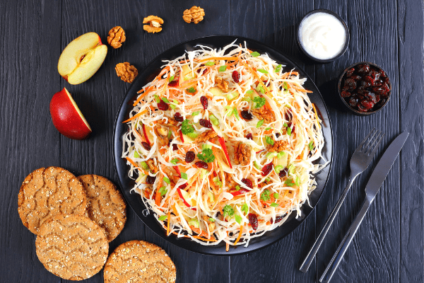 Make coleslaw tastier by adding apples and cranberries! Include this festive side dish with your next cookout or potluck.