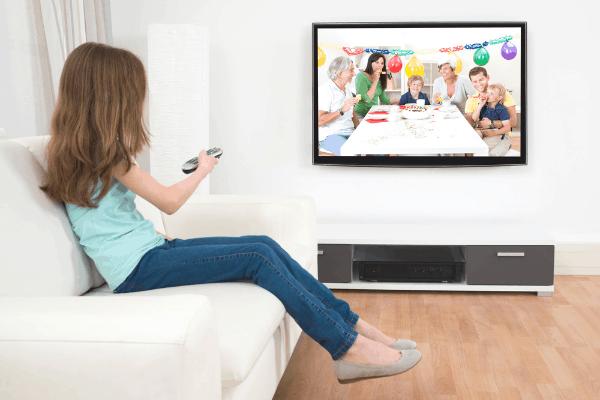 Girl alone watching tv