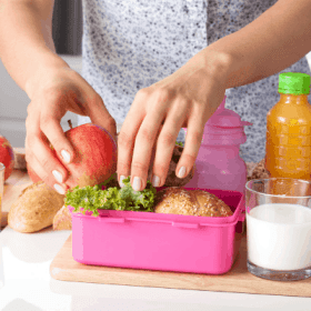 Mom packing healthy school lunch