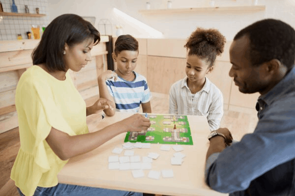 A list of the highest-rated, best board games for families to help you choose what to play on your next family game night!