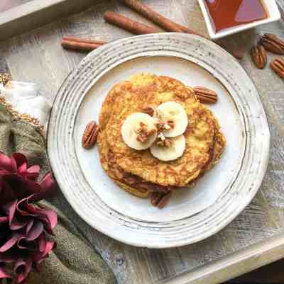 easy gluten-free, paleo-friendly pancakes topped with banana slices and nuts on a plate