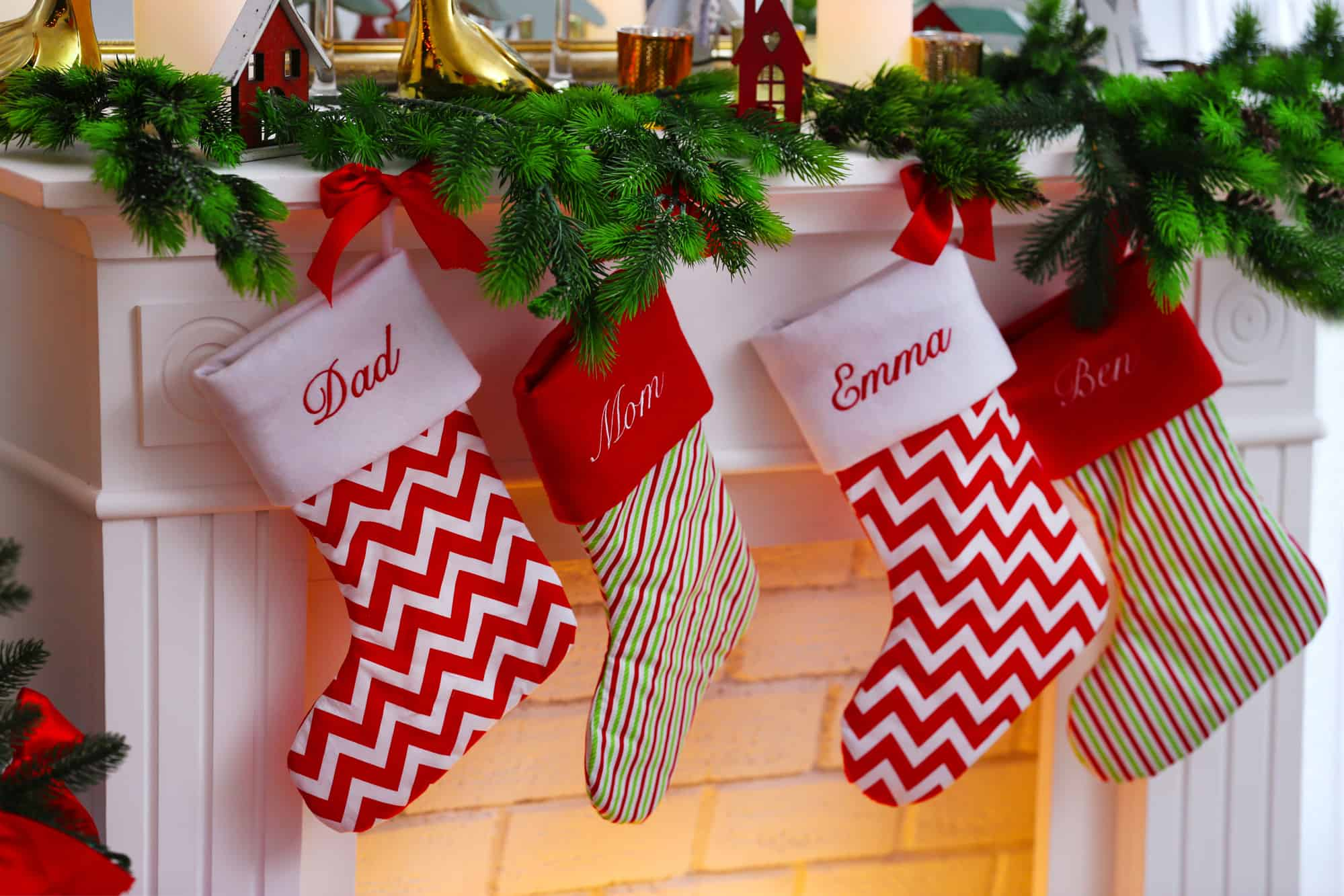 Stockings hanging over the fireplace waiting to get filled with one of the best toddler stocking fillers ideas on this list!