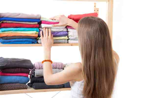how to get organized for the new year? woman cleaning her closet