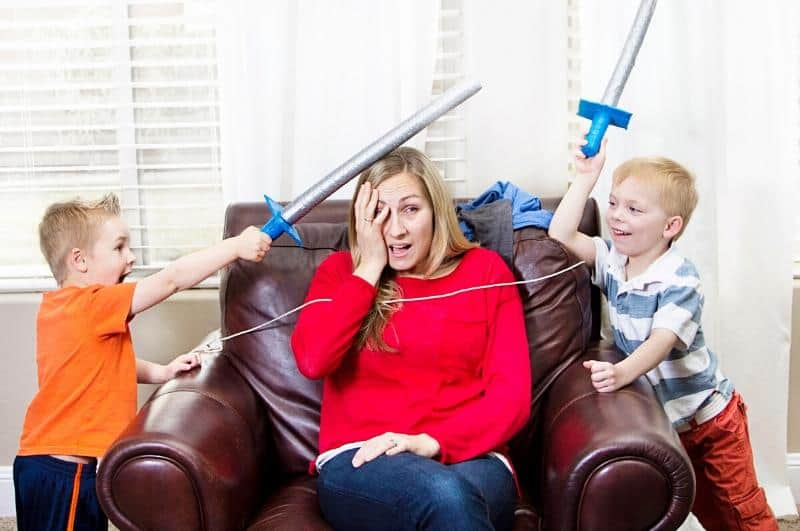 overwhelmed mom with fighting boys