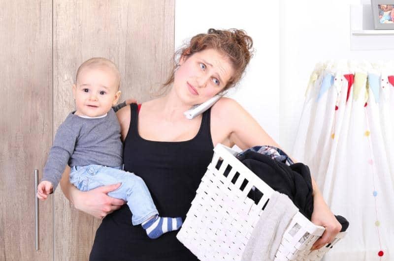 overwhelmed mom multi-tasking