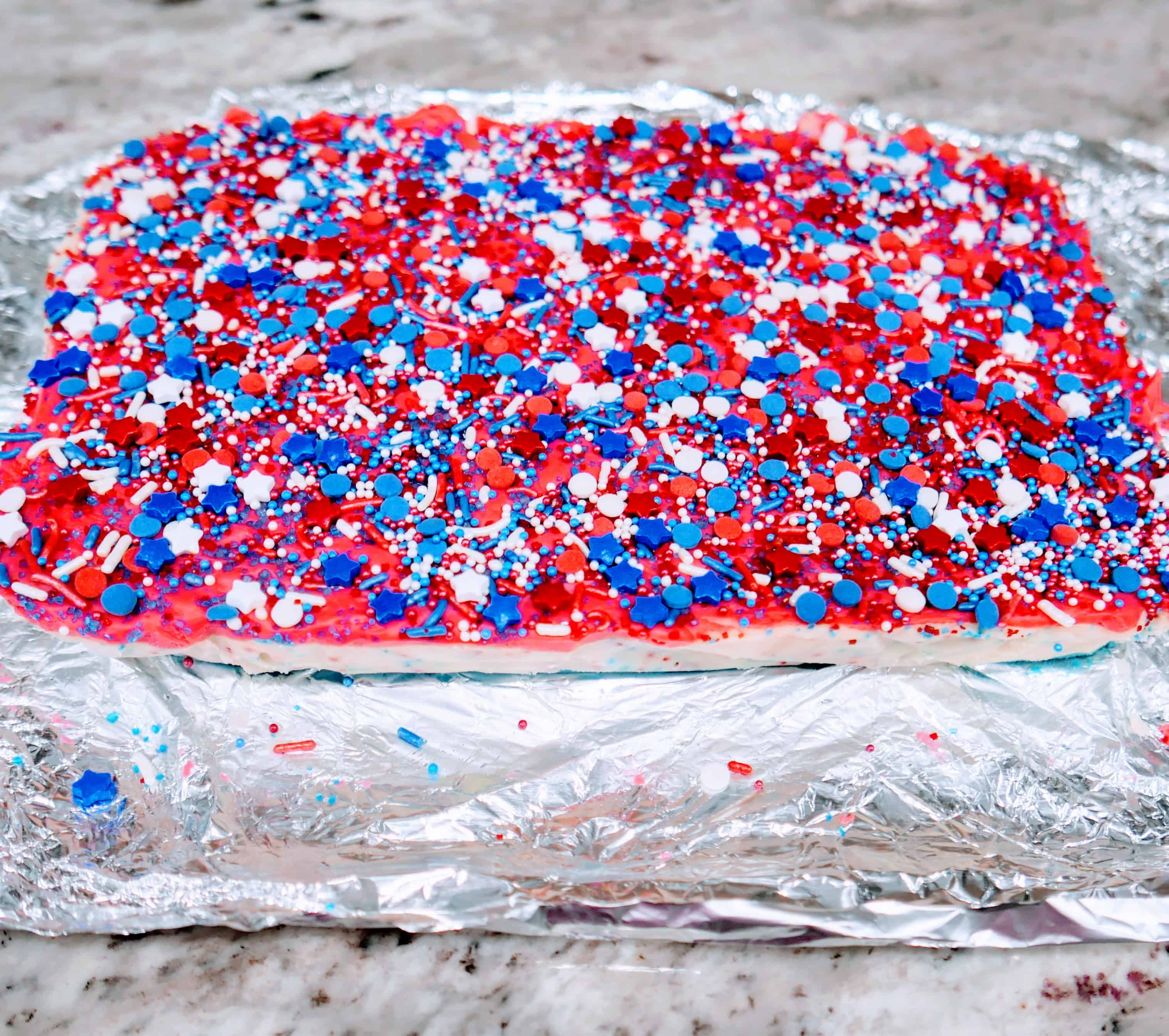 all the layers of fudge put together with sprinkles on top