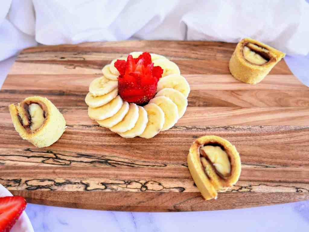 banana sushi rolls on a wooden board