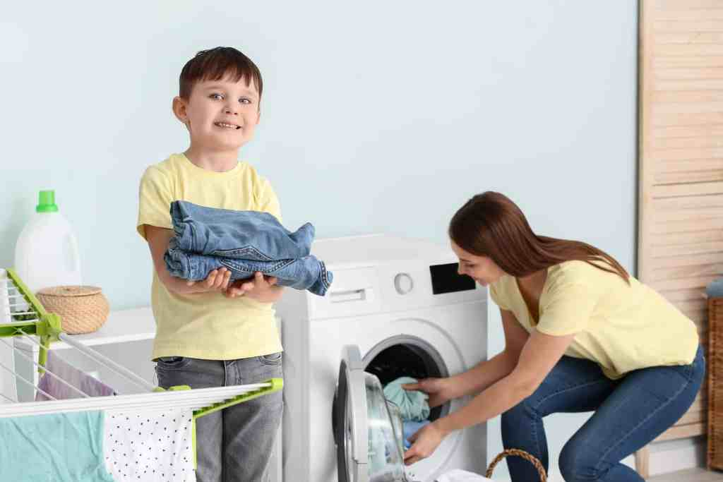 boy helping mom with laundry