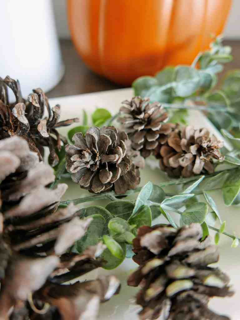 close up of DIY scented pine cones and greenery