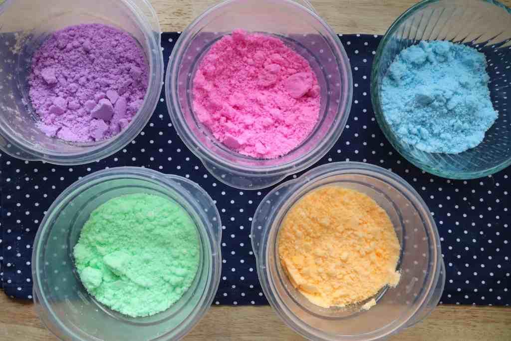 bowls of colored bath bomb mixture