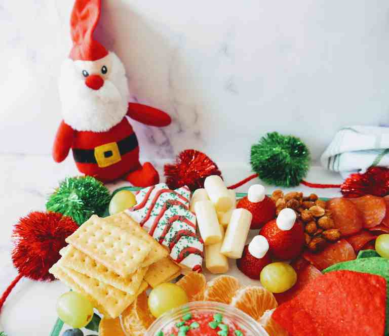 holiday charcuterie board with stuffed Santa