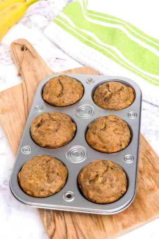 baked banana protein muffins in muffin tin