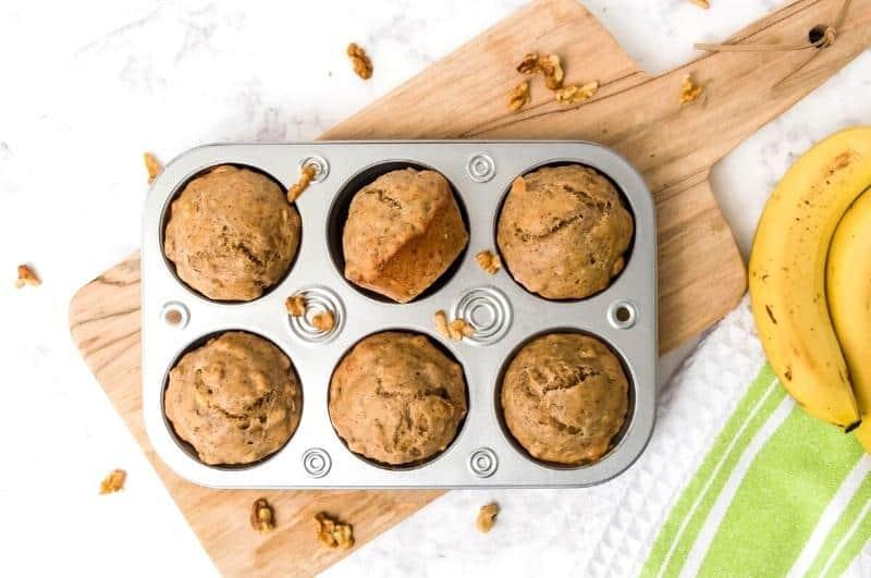 banana protein muffins in a muffin tin