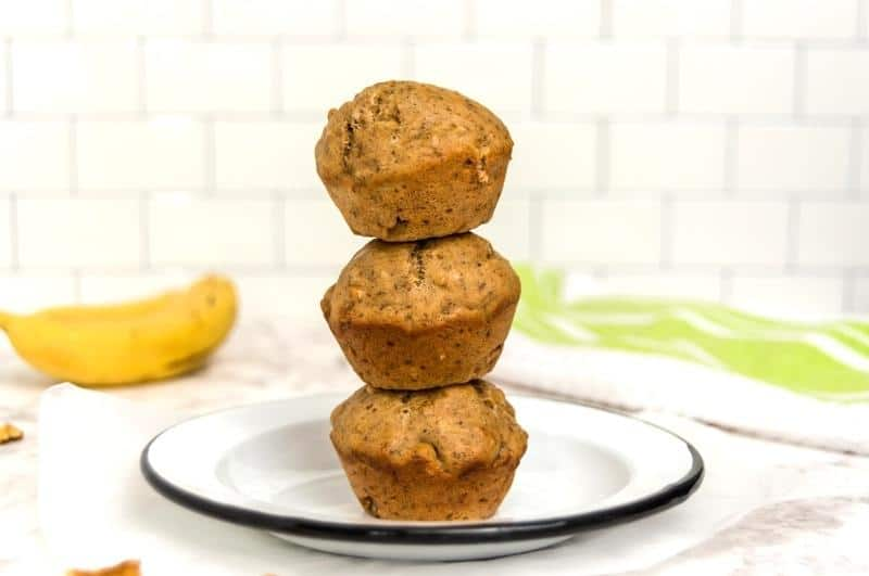 stacked banana protein muffins on a plate