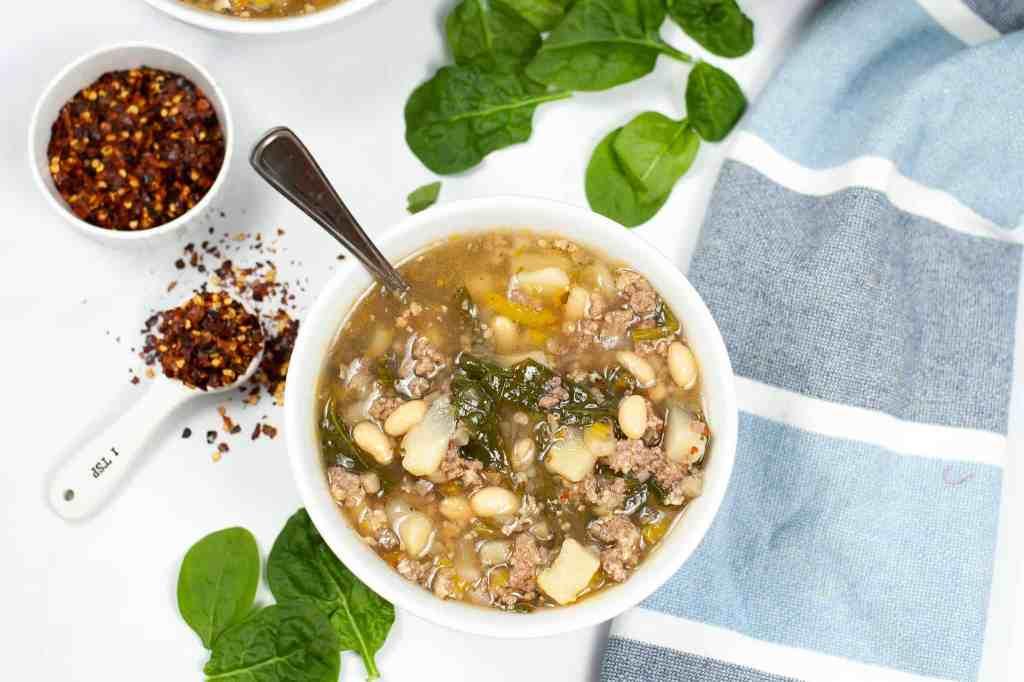 bowl of IP Sausage Potato Spinach Soup
