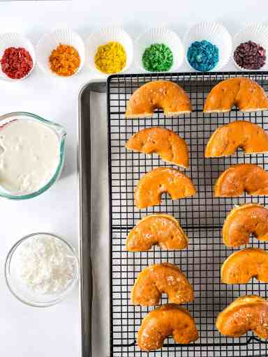 Ingredients for Rainbow Donuts! Make these fun donuts with fruity pebbles, white frosting, and coconut! They are SO easy to make that you'll do it again and again to your kids' delight!