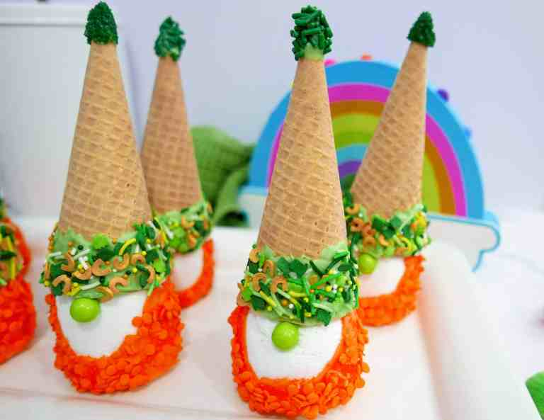 St. Patrick's Day gnomes on a white tray with a rainbow in the background