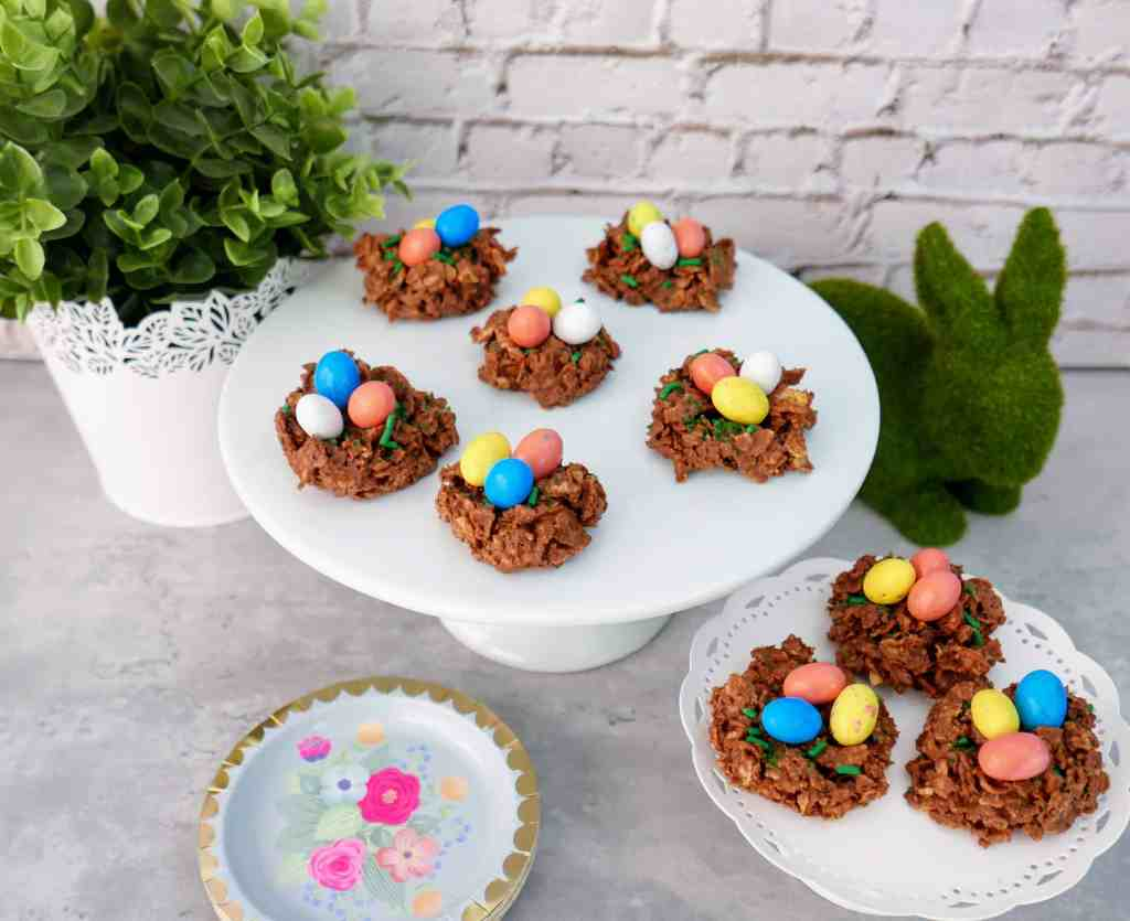 Chocolate and Peanut Butter Bird's Nest Cookies - a sweet Easter treat that is quick, easy, and FUN to make! These bird's nest treats have a twist from the typical way of making them and are kid-approved and lip-smackin' good!! These Easter Bird's Nest cookies are a traditional Easter recipe with a fun new twist. Plus they're SO CUTE! #Easter #birdsnest #nobake #cookies #dessert #treats