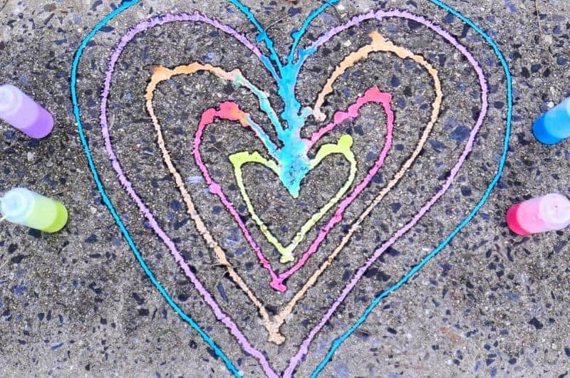 colorful heart on pavement made with sidewalk chalk