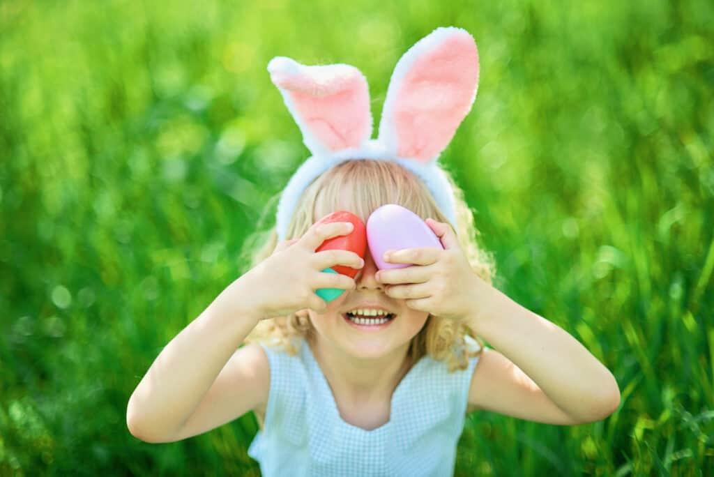 girl laughing at Easter egg scavenger hunt