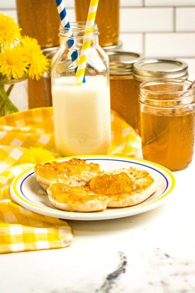jars of jelly and an English muffin on a plate