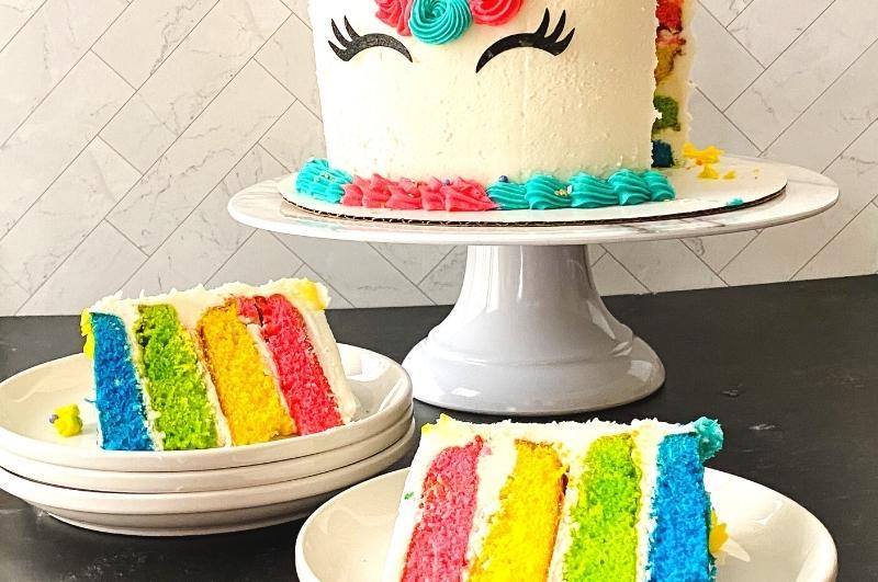 rainbow birthday cake with cut slices