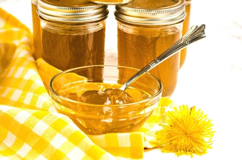 dandelion jelly in jars and a bowl