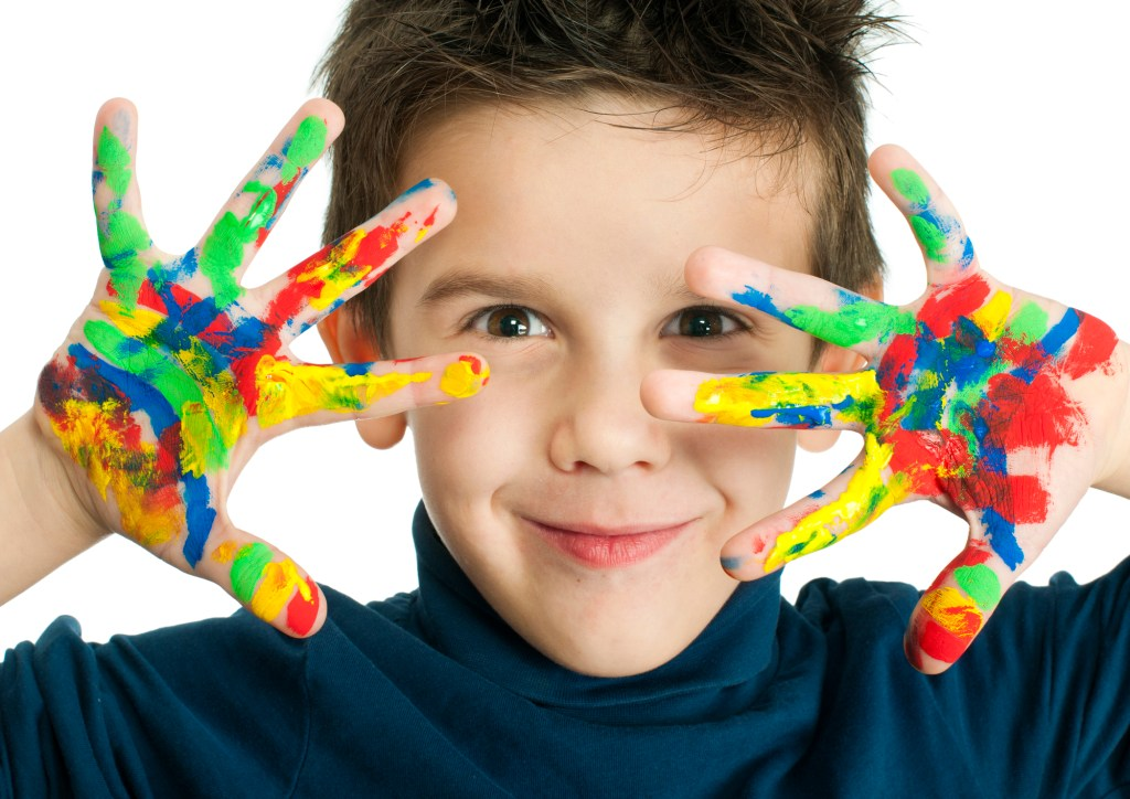 boy with paint on this hands